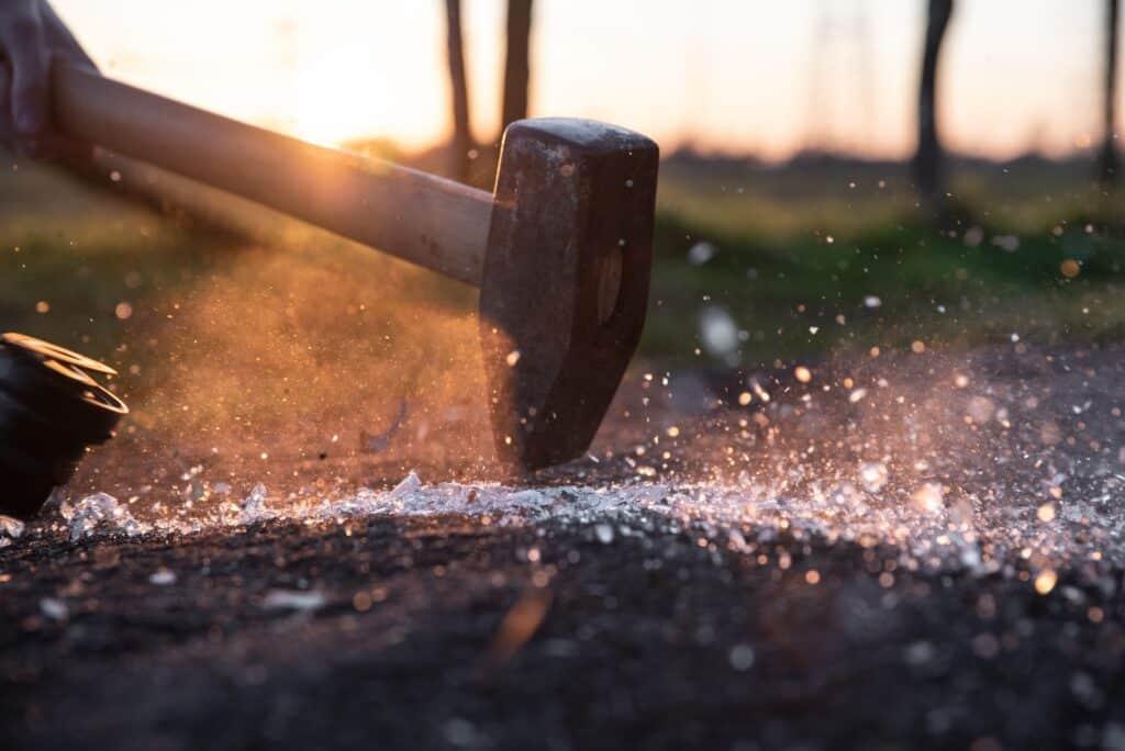 Cutting rocks with hammer
