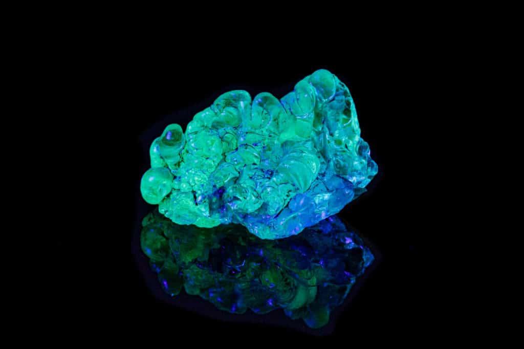 Opal Stone Glowing Under UV Light